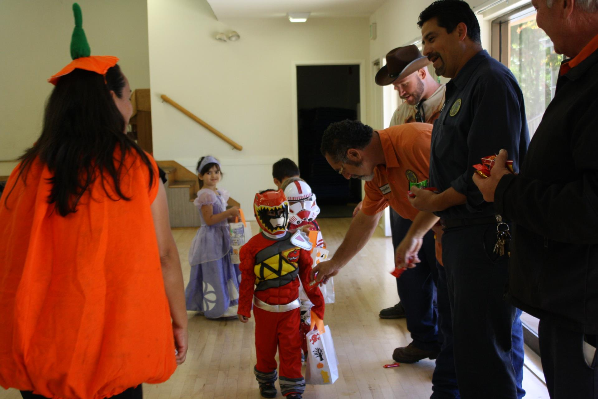 Children dress up and collect candy.