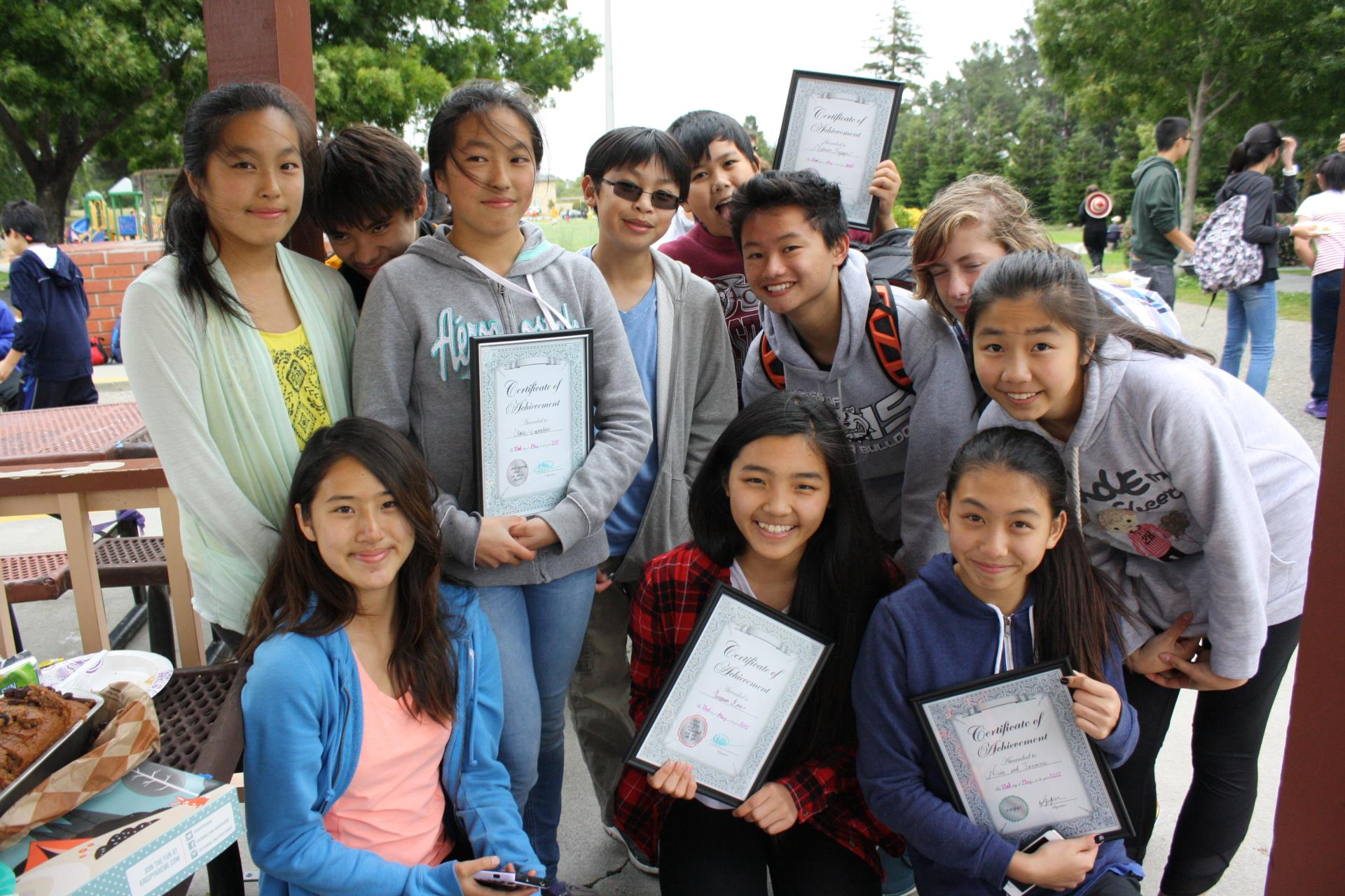 Youth Sports badminton present certificates.