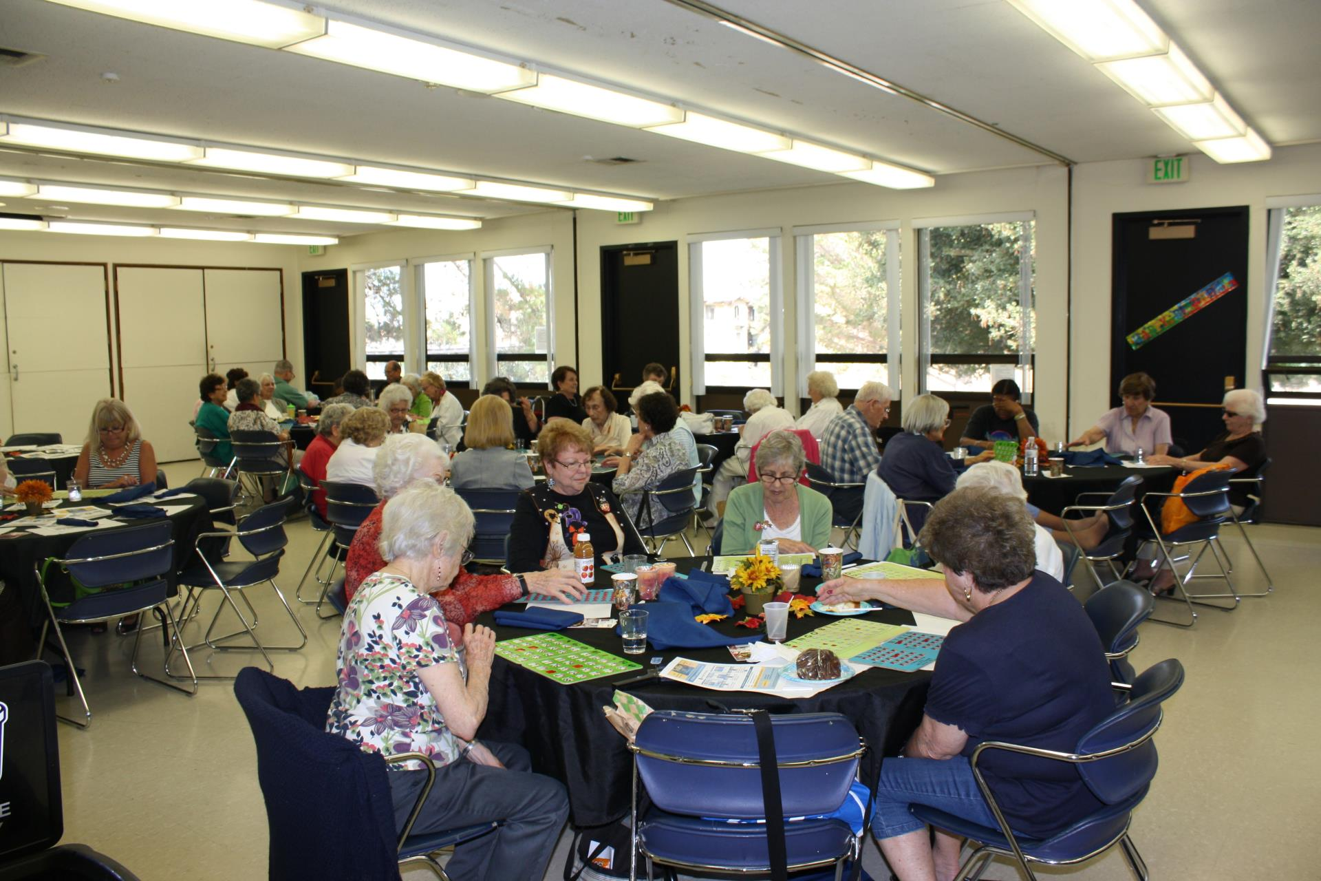 Participants socialize at the monthly Senior Luncheon.
