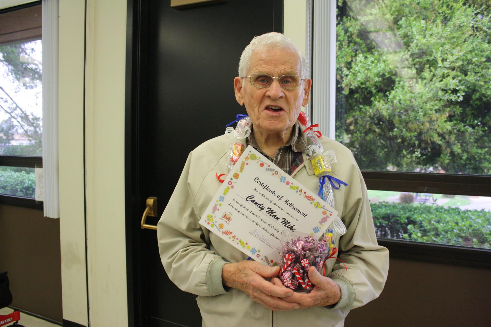 """Candyman Mike"" is honored and thanked for handing out candy for 15 years."